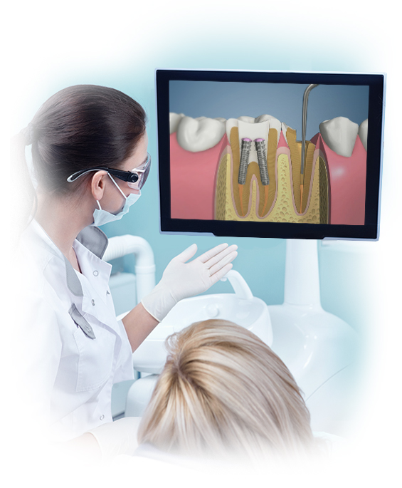 dentist showing dental software to patient in dental chair