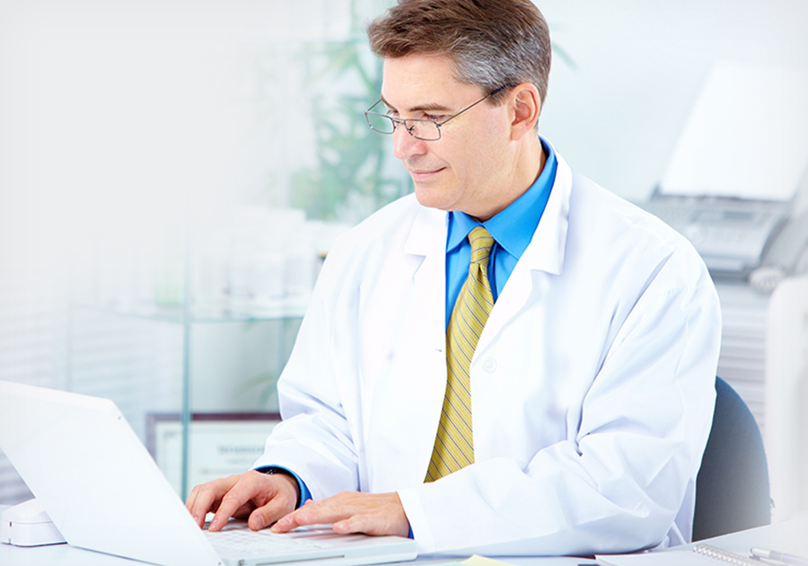 Doctor taking notes using dental notes software